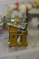 Antique tin toy pupil at desk (25563387933).jpg