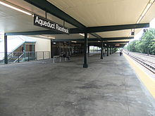Covered platform with railroad track at right
