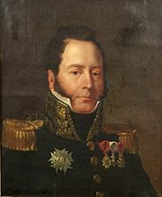Painting of a clean-shaven man with dark hair and sideburns reaching almost to the ends of his mouth. He wears a dark blue military uniform with epaulettes.