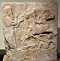 Assyrian wall relief showing a scribe and a horseman trampling enemies. From Anah, Iraq. Iraq Museum.jpg