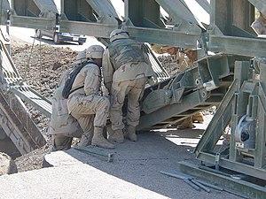 Medium Girder Bridge - Image: Attaching the link reinforcement set to the Medium Girder Bridge. Mosul, Iraq, 2003