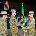 Australian Army Col. Wade Stothart, right, the commander of Combined Team Uruzgan, accepts the unit's flag from Maj. Gen. Gus McLachlan, center, the deputy chief of staff for plans of the International Security 130807-O-MD709-126-AU.jpg