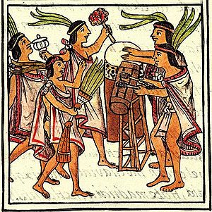 "Florentine Codex - An illustration of the ""One Flower"" ceremony, from the 16th-century Florentine Codex. The two drums are the teponaztli (foreground) and the huehuetl (background)."