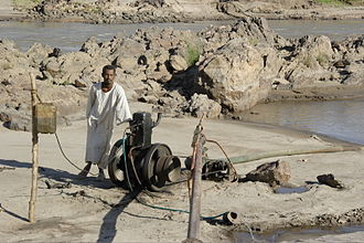 Agriculture in Sudan - A Sudanese farmer operating an irrigation pump