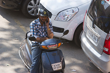 Bangalore guy on phone with ferrari helmet November 2011 -45.jpg