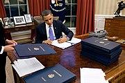 BarackObamaSigningLegislation