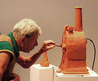 Barry Brickell - Barry Brickell stoking a miniature clay kiln at the opening of an exhibition at the Brett McDowell Gallery in Dunedin, October 2013.