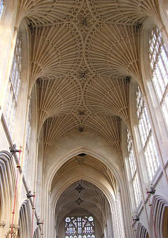 Nave - Late Gothic fan vaulting (1608, restored 1860s) over the nave at Bath Abbey, Bath, England. Suppression of the triforium offers a greater expanse of clerestory windows.