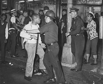 Bedford Stuyvesant Restoration Corporation - Confrontation between black rioters and police at Fulton Street and Nostrand Avenue during the 1964 riot