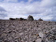 The summit plateau. The ruined observatory is in the centre, with the summit cairn to the right.