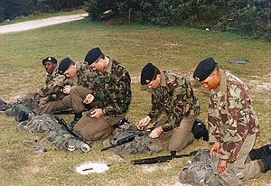 Conscription in the United Kingdom - Bermuda Regiment recruits clean their Ruger Mini-14/20GB rifles prior to a shoot at Warwick Camp during the 1994 Recruit Camp.