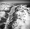 Blockade Glacier and Blockade Lake, iceberg filled lake at dead branch of glacier, trimline along valley walls, and jagged folia (GLACIERS 6427).jpg