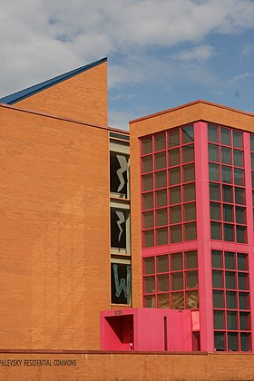 Max Palevsky Residential Commons, a dormitory completed in 2001 designed by postmodernist Mexican architect Ricardo Legorreta. Blue, orange and pink.jpg