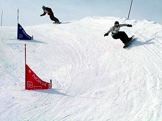 Snowboard cross competition in which a four to six snowboarders race down a course