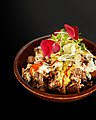 Breakfast poutine with hollandaise spiced ground beef, mushrooms, caramelized onions & cheese mix with a poached egg.jpg