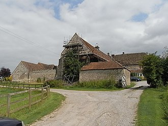 Brook, Heywood - Brook Hall viewed from S-W, 2011. The western gable-end of the mediaeval wing, shored-up with scaffolding, is visible in centre