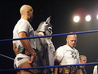Bruderschaft des Kreuzes - Castagnoli (left) and Ares (right) as the Campeones de Parejas in April 2010, with Tursas (center).