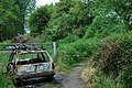 Burnt car at the footpath fork. - geograph.org.uk - 182150.jpg