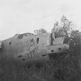 72d Test and Evaluation Squadron - Pin-up girl painted on a dumped American World War Two aircraft. Aircraft identity: B-24 Liberator bomber, serial number 44-40546, nose art Two Time, assigned to 72nd Bomb Squadron, 5th Bomb Group, 13th Air Force.