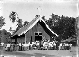 Larantuka - Group Portrait with missionary pastor J. van der Loo in front of the Roman Catholic church in Konga (circa 1915)