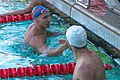 Caeleb Dressel is congratulated by Tripp Cooper after winning 100 fly (42769913941).jpg