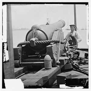 CSS Ivy - 6.4-inch banded rifle, the weapon type used as the bow pivot gun on the CSS Ivy. Note the 100-pound conical projectile at the right rear of the gun carriage. This image is from the Library of Congress.