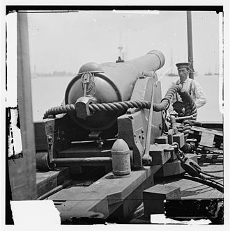 Battle of the Head of Passes - 6.4-inch banded rifle, the weapon type used as the bow pivot gun on the CSS Ivy. Note the 100-pound conical projectile at the right rear of the gun carriage. This weapon outranged all of the guns in Pope's fleet.