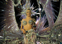 Smiling young woman in Carnival Queen costume