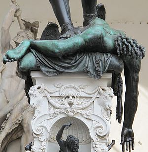 Perseus with the Head of Medusa - The base of the sculpture, Perseus' feet on the slain Medusa's headless corpse