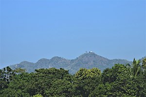 Chandranath Hill, also known as Sitakunda Hill, as seen from the Dhaka-Chittagong railroad. It is the tallest peak in Chittagong district, and is the location of Chandranath and Birupakkha temples.