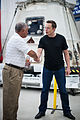 Charles Bolden congratulates SpaceX CEO and Chief Designer Elon Musk in front of the historic Dragon capsule.jpg