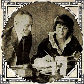 Charles Pathé - Charles Pathé and Ruth Roland at the signing of her contract in 1919