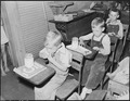 Children of miners eating lunch in schoolroom. Mother of children in 1st two seats brought lunch to school for them.... - NARA - 541236.tif