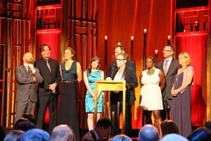 "Doc McStuffins - Creator and Executive Producer Chris Nee accepts the Peabody for ""Doc McStuffins"" along with Darragh O'Connell, Norton Virgien, Theresa Mayer, Chelsea Beyl, Kent Redeker, Kerri Grant, Cathal Gaffney, and Gillian Higgins."