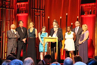 """Doc McStuffins - Creator and Executive Producer Chris Nee accepts the Peabody for """"Doc McStuffins"""" along with Darragh O'Connell, Norton Virgien, Theresa Mayer, Chelsea Beyl, Kent Redeker, Kerri Grant, Cathal Gaffney, and Gillian Higgins."""