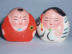 A Fu - A pair of A Fu clay figurines