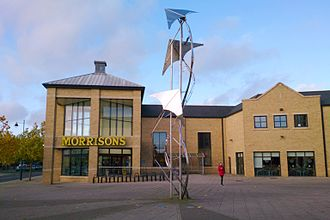 Cambourne - Morrisons supermarket and flight-themed sculpture commemorating the area's connections with the RAF and World War 2 aeroplane production
