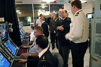 Collins-class submarine - U.S. Secretary of the Navy Donald C. Winter observing the Collins Weapon System Trainer Facility at HMAS Stirling in August 2007