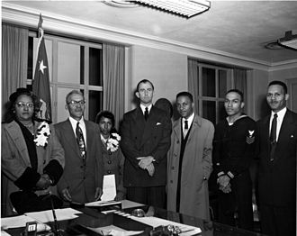 Frank Pace - Pace (center) with the family of Medal of Honor recipient Cornelius H. Charlton in 1952.