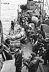 Crewmen hoisting the whaler back aboard HMS Wells (6105881518).jpg