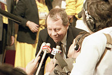 Colour photograph of former federal Indian affairs minister David Crombie speaking to reporters on the floor of the 1983 Progressive Conservative leadership convention