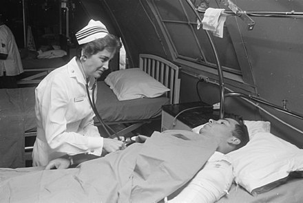 Da Nang, South Vietnam, 1968 Da Nang, South Vietnam...United States Navy nurse Lieutenant Commander Joan Brouilette checks the condition of Pfc.... - NARA - 558531.jpg