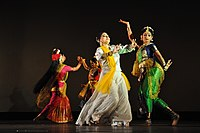 Four women wearing saree in different dancing poses.