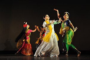 Four women wearing saree in different dancing poses