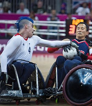 David Anthony (wheelchair rugby) - David Anthony (left) challenges William Groulx during the 2012 Summer Pralympics