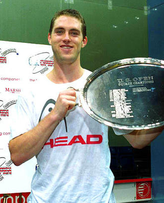 David Palmer (squash player) - Palmer holding a plate trophy after winning the 2002 US Open.