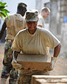 Defense.gov News Photo 100413-F-3495A-009 - U.S. Air Force Senior Airman Shamika Moore a member of the 127th Civil Engineering Squadron Michigan Air National Guard carries a cement.jpg