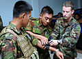 Defense.gov News Photo 100505-N-8377A-039 - U.S. Navy Petty Officer 2nd Class Caleb Murray right of Riverine Squadron 1 works with two members of the Royal Brunei Navy Support Squadron to.jpg