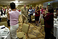 Defense.gov News Photo 100510-N-0696M-078 - Chairman of the Joint Chiefs of Staff Adm. Mike Mullen arrives to standing applause at the quarterly Continuum Of Resource Education spouses.jpg