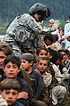 Defense.gov News Photo 100913-A-1987K-662 - Pakistani children wait to be moved onto a U.S. Army CH-60 Black Hawk helicopter for evacuation in Khyber-Pakhtunkhwa province Pakistan on Sept.jpg